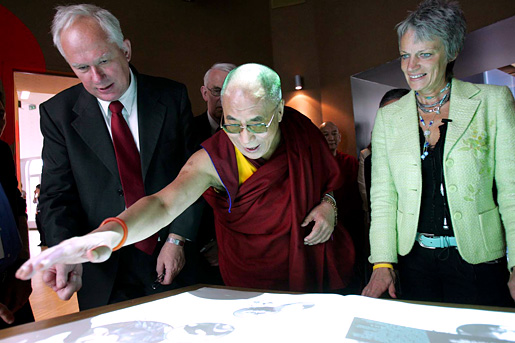 Dalai Lama, together with Geir Lundestad, Director of the Norwegian Nobel Institute, and Bente Erichsen, Director of the Nobel Peace Center, viewing the exhibition at the Nobel Peace Center in June 2005.
