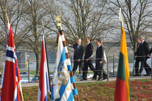 "NATO Secretary Jaap de Hoop Scheffer; Barack H. Obama, President of the United States of America and Nicolas Sarkozy, President of France crossing the ""Passerelle de deux rives"" from Germany into France"