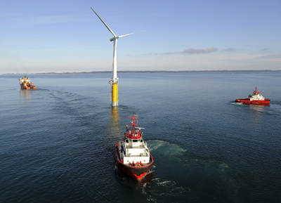 A Hywind floating wind turbine being hauled to sea off Norway. (Credit: Siemens)