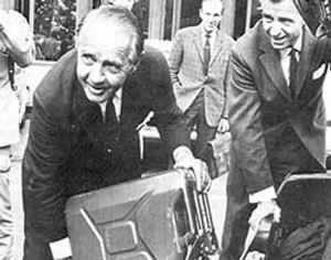 Photo: Norwegian Petroleum Directorate 1970: Industry minister Sverre W. Rostoft proudly displays the first petrol made from Norwegian oil—a few drops from Balder.