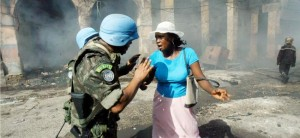 United Nations peacekeepers help a street merchant in Haiti's capital after a fire in 2004. Photo: UN Photo/Daniel Morel