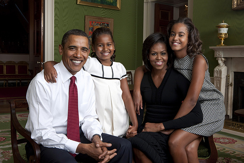 President Barack Obama, First Lady Michelle Obama, and their daughters, Malia and Sasha, sit for a  family portrait in the Green Room of the White House, Sept. 1, 2009. (Official White House Photo)