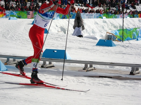 Team USA Bill Demong races for Nordic Gold in 2010 Olympics. (photo Roland Tangalo).