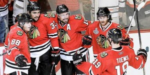 Patrick Kane (88), Dustin Byfuglien (33), Patrick Sharp (10), Duncan Keith, and Jonathan Toews (19) celebrate Sunday night.  PHOTO AP