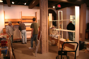 Staff and volunteers help set up shelving in Vesterheim's new Museum Store.