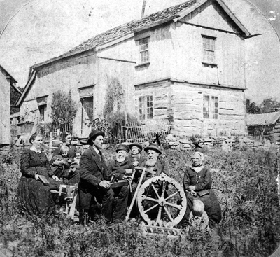 Aslak Olsen Lie and his wife Marit (far right) in front of their Wisconsin home in 1874. Photo courtesy of Folklore Village.