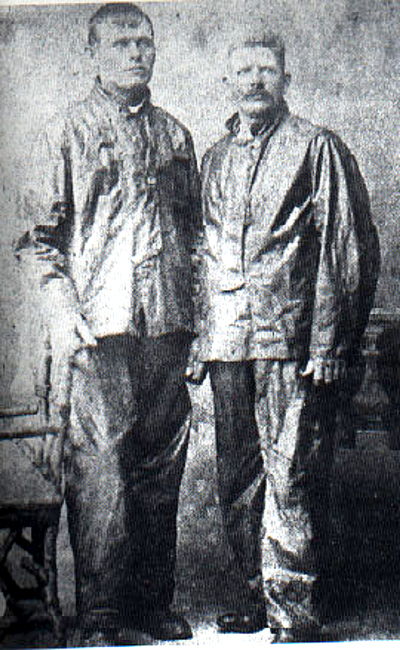 Wearing their foul weather gear, Frank Samuelsen shows he is significantly taller than his rowing partner George Harbo. Photo courtesy of Bill Osmundsen
