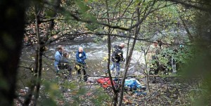 Police search for evidence on the banks of the Alna River in Oslo.