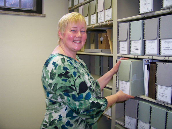 Jackie Henry, the administrative director of the Norwegian American Historical Association (NAHA), provides help to researchers and genealogists to access the organization's extensive archives. Photo courtesy Leslee Lane Hoyum