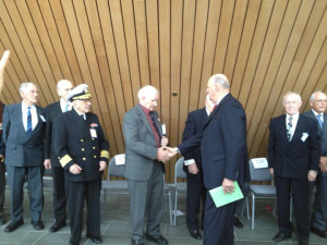 Olav Vedvik shakes the hand of HM King Harald. Photo courtesy Lori Vedvik.
