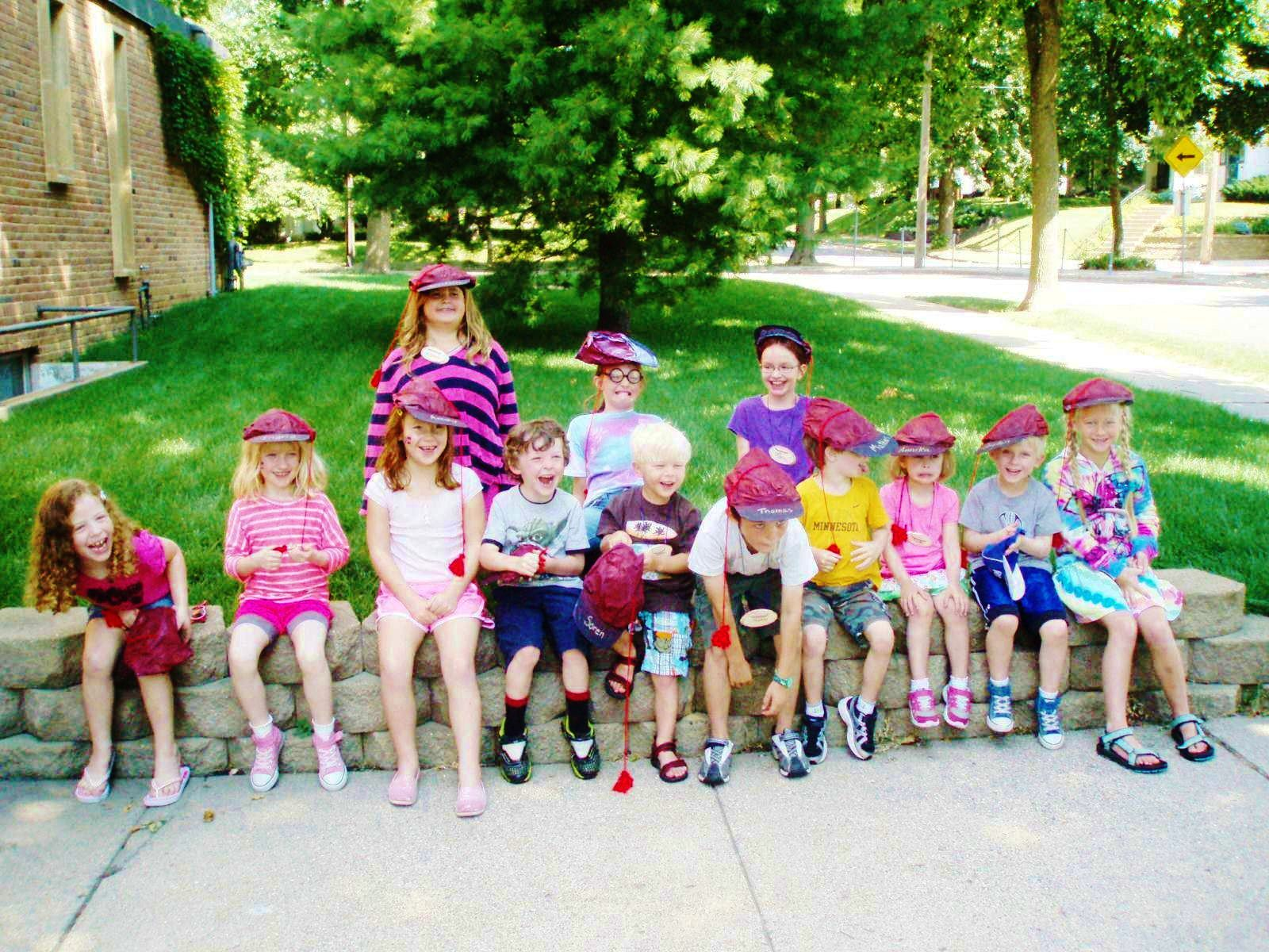 Photo: Valerie Borey Caption: Summer participants in Concordia Language Villages' Norwegian Day Camp (Twin Cities). Our theme for the week was Russefeiring - we wore russeluer, drove a russebil made out of cardboard, made our own russedrakter, and tied knots in our tassels for each prank or challenge we pulled off! We even tried pickled herring! And of course we spoke Norwegian all week long!