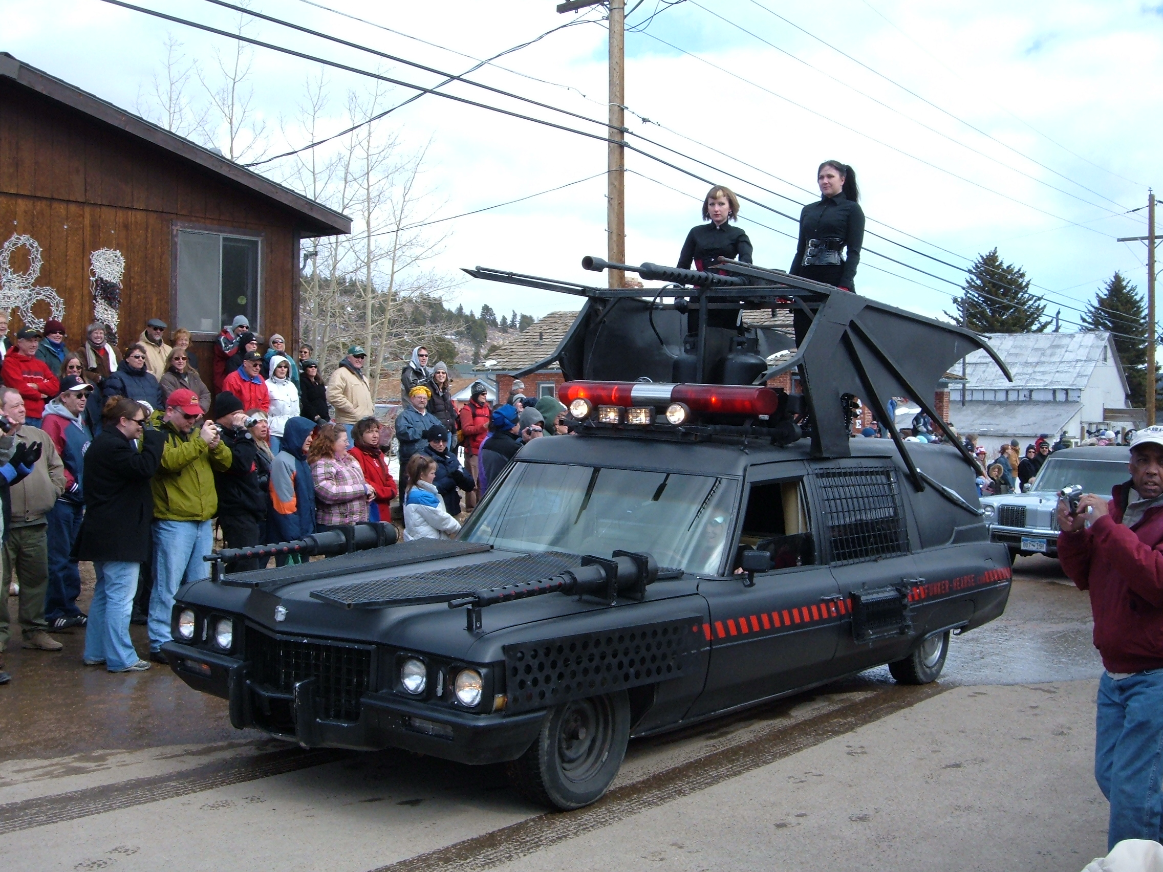 """Photo: Matt Beldyk/Flickr A decorated hearse in the Frozen Dead Guy Days parade of hearses. Other events include coffin races, polar plunge, frozen salmon toss, and a """"frozen dead guy"""" lookalike contest."""