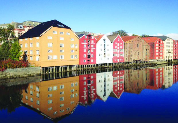 Photo: David Nikel A view of the river from the old town bridge, showing restored warehouses on stilts.