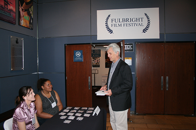 Photo: Larrie Wanberg Professor Glenn Gebhard greeting UCLA student volunteers at the registration table.