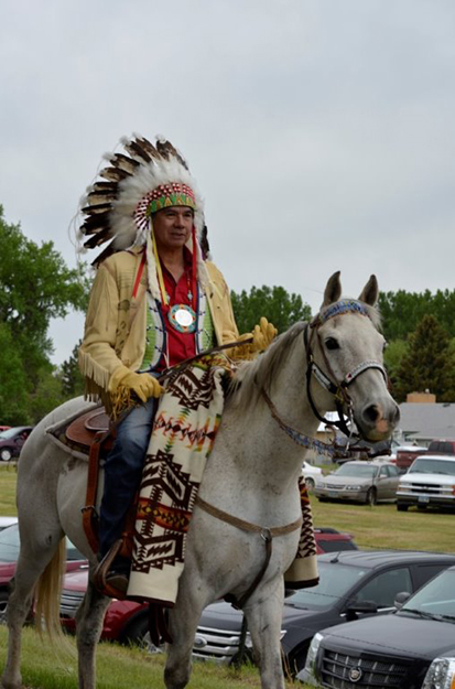 """Photo: Robert Leitner Chairman Tex Hall of the MHA Nation leads the """"Homecoming"""" parade to the Knife River homeland."""