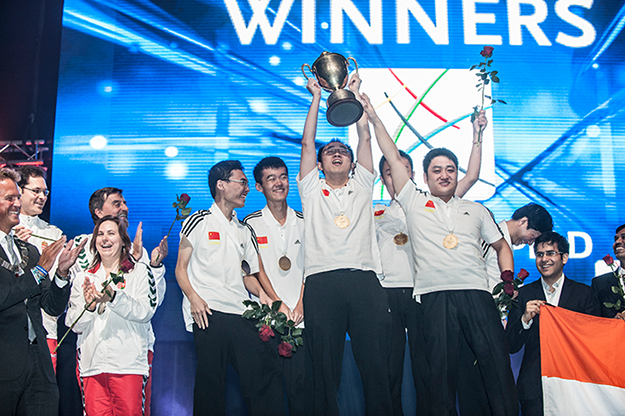 Photo: Chess  Olympiad Norway 2014 /  Facebook  Team China, as first-place winner, hoists the Hamilton-Russell cup.