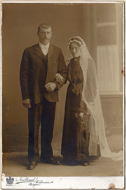 Photo courtesy of Jon Lind My grandparents' wedding picture from 1916. Wedding dresses were typically black in those days. Sadly, my grandfather died in November 1917 of cancer, a few months after the birth of my father. At the time of his death he was 33 and she was 31. She had to sell the farm they bought the year before, but managed to do so at a considerable profit.