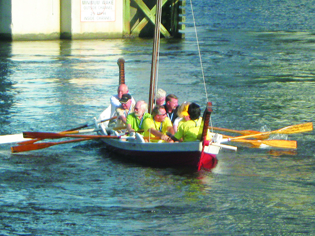 Photo: Barbara K. Rostad Adventurous attendees at the Sons of Norway International Convention in Jacksonville tackle the task of synchronizing oars aboard the Viking boat owned by Gateway-to-Florida Lodge #3-541.