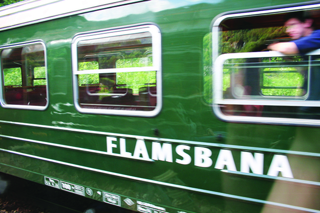 Photos: Mortendreier /  Wikimedia Commons The Flåm Railway speeds past, delivering stunning views to passengers.