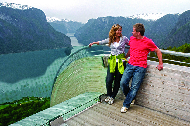 Photo: C. H. / Visitnorway.com A couple enjoys the view from Stegastein.