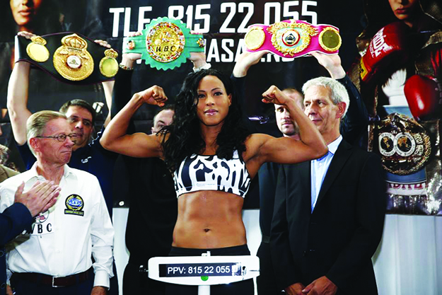 "Photos: ""The First Lady"" Cecilia Brækhus / Facebook Brækhus shows off her guns at the weigh-in before the fight."