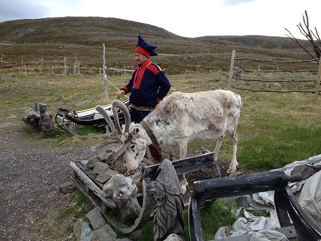 Photo: Emily C. Skaftun  Alongside the road near Nordkapp, Sami reindeer herders tap another source of revenue by selling handicrafts—and by allowing tourists to take photos of them.