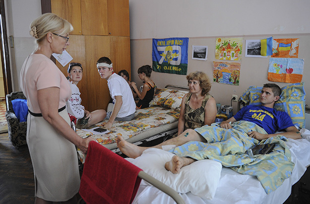 Photo courtesy of Marit Fosse Minister of social policy Liudmyla Denisova hears the concerns of patients and families.