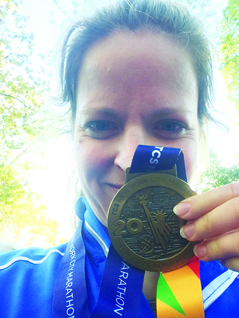 Photos courtesy of Annette Orre  Annette poses with her medal after completing the New York City Marathon.