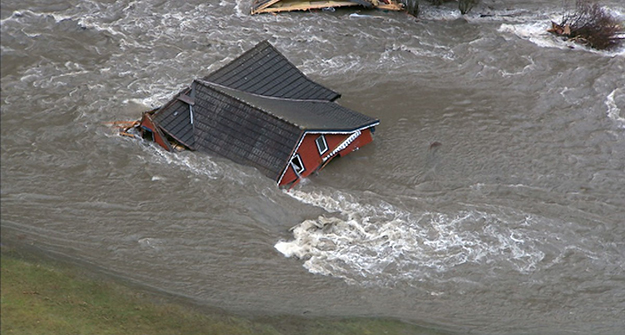 Photo: NRK Many homes were destroyed in last week's severe flooding in Western Norway, like this house in Flåm that was washed entirely away.