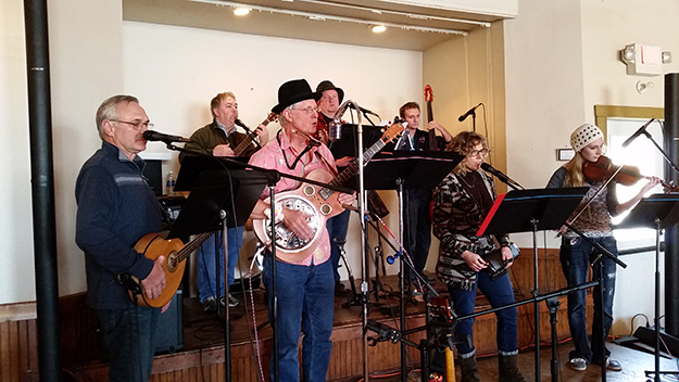 Photo: Ellen Schafer The Bravehearts Band entertained at the Prairie Pastry Festival. From left to right: Terry Mastel on octave mandolin, Greg Lord (back), Adrian Jacobs, Jason Jacobs (back), Trevor Griffin (back), Kriste Erickson (lead vocals, front), and Megan Griffin on Violin.