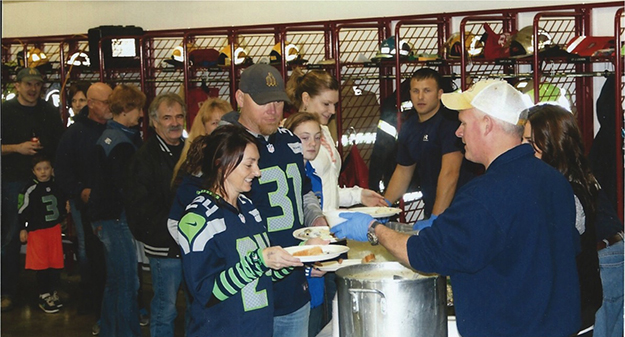 Photo: courtesy of Solveig Lee Seahawks fans line up for crab.