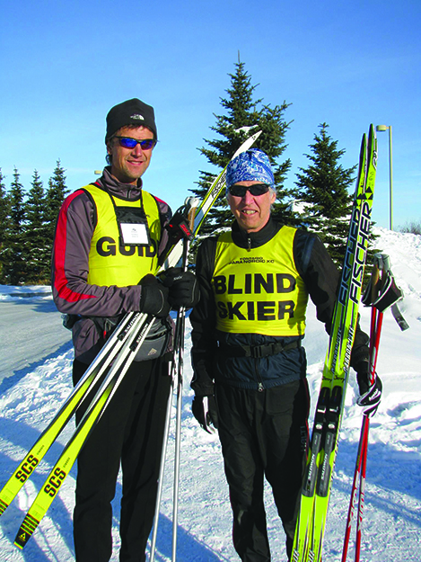 Photo: Ski for Light / Facebook Guides pair up with visually impaired skiers.