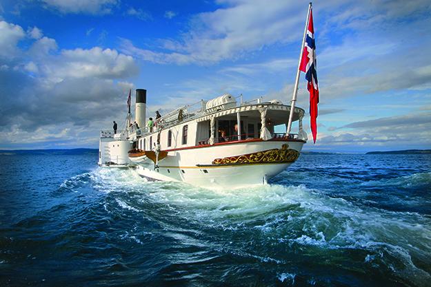 Photo: Colin Dobinson / Oplandske Dampskibsselskap Skibladner on Lake Mjøsa. Inside it boasts a saloon and a fine restaurant.
