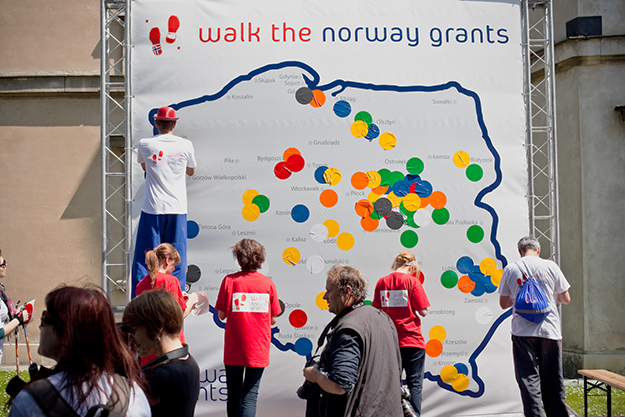 "Photo: EEAgrants.org  Close to 250 people turned out in the old town square in Warsaw in May 2011 to ""Walk the Grants."" The Norwegian Embassy in Warsaw invited representatives from all funded projects to participate in the Nordic walking event, celebrating the achievements of the more than 400 projects and funds implemented in Poland to date."