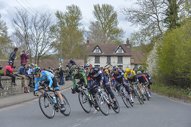 Photo: © A.S.O. / G. Demouveaux  Above: Nordhaug leads the pack through the village of North Grimston in Stage Two of the race.