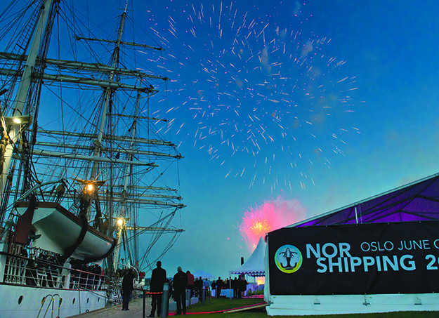 Photo: Nor-Shipping 2015  Fireworks at the pier in Oslo; illuminate the sailing ship Christian Radich.