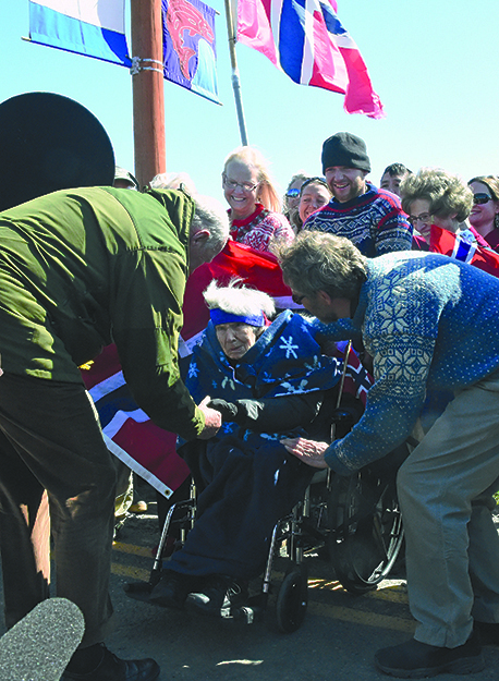 Photos: Sven Gj. Gjeruldsen,  The Royal Court of Norway The king greets 102-year-old Margit Andersson in Homer, Alaska.