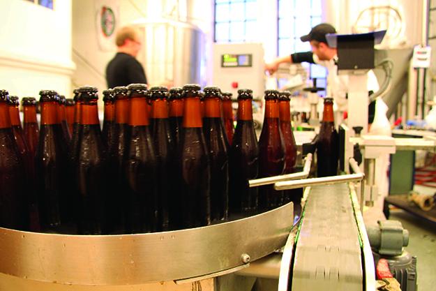 Photo: courtesy of Nøgne Ø Beer is bottled inside Nøgne Ø's Grimstad brewery.