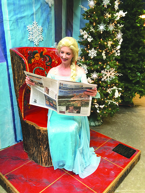 Photo: Emily C. Skaftun Where else would Elsa get her news? The ruler of Arendelle takes a moment to peruse the Norwegian American Weekly.