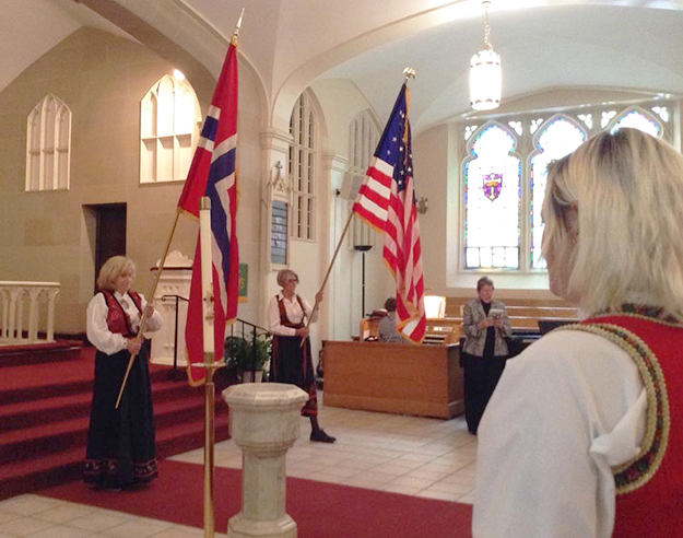 Photo: Ester Hall Sigrun Larsen and Solveig Simonsen Mcloughlin bring in the flags.