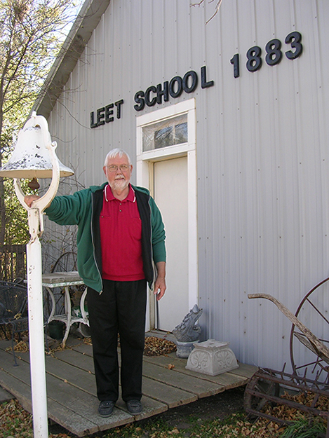 Photo: Cynthia Elyce Rubin Richard Christopher with the schoolhouse in his backyard.