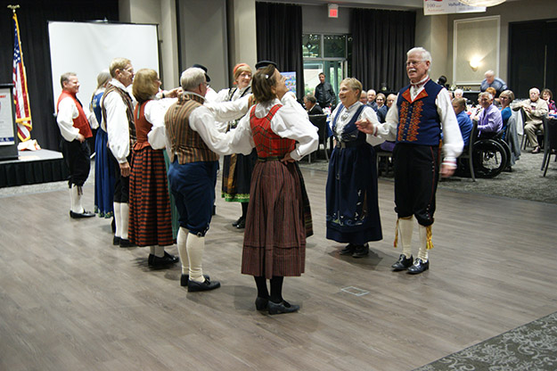 Photo: Bradley Goplen Leikarringen Heimhug Folk Dancers of Chicago, who themselves recently celebrated 90 years, entertained the guests.