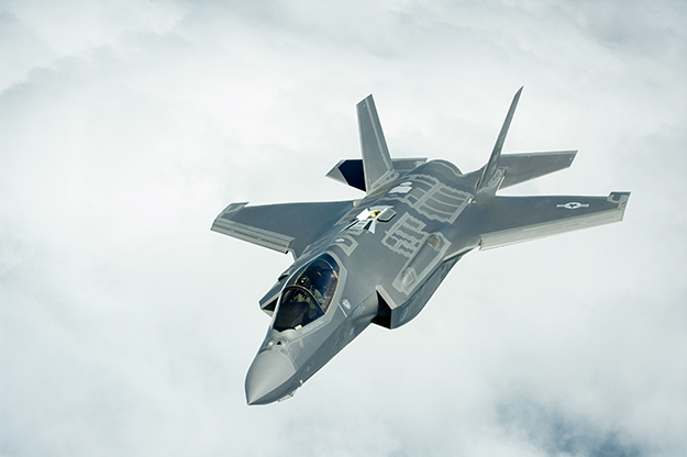 Photo: Department of Defense / Wikimedia An F-35A Lightning II jet against a cloudy sky.