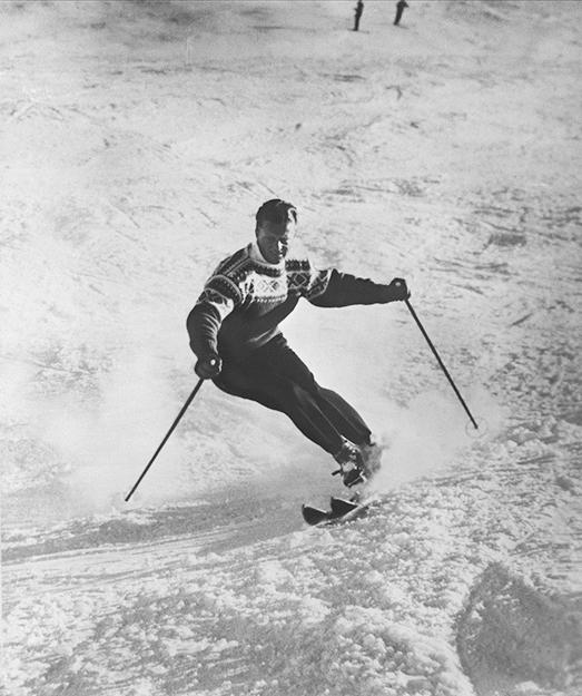 """Photo: Oslo Museum / Wikimedia Commons Stein Eriksen skiing in his """"Cortina"""" pattern Norwegian sweater."""