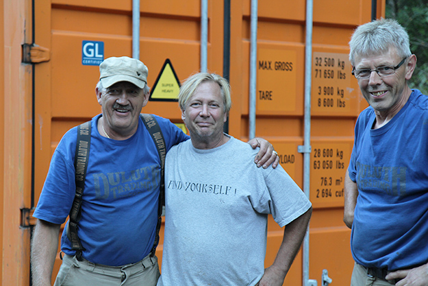 Photo: Arne Asphjell Friendships across the Atlantic: Oddmund Stenset, Scott Winner, and Ansgar Selstoe celebrate successfully packing up the building. It's a bittersweet moment for the Americans, but all are pleased that the church will have a loving new home.