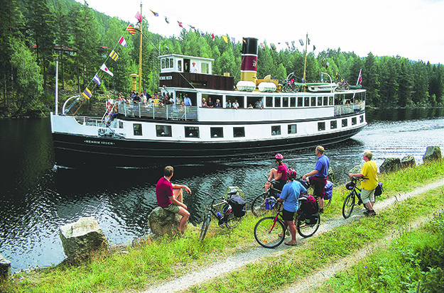 Photo: Vidar Askeland / Visitnorway.com There are many ways to enjoy the Telemark Canal; by boat and by bike are two popular options.