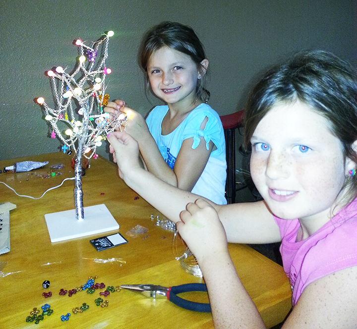 Photo courtesy of Jeremy Jacobs Adley and Ava Brae make a Night Light version of the Birthday Tree.