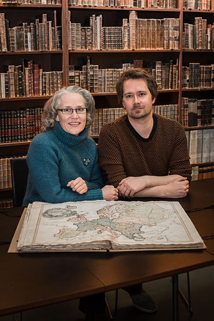 Photo: Nikolaj Blegvad / The National Library of Norway Benedicte Gamborg Briså and Anders Kvernberg sit with the copy of the Cedid Atlas that he found.