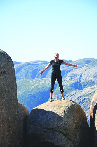 Photo courtesy of Laura Aanonsen Laura Aanonsen stands atop Kjeragbolten during her year at folkehøgskole.