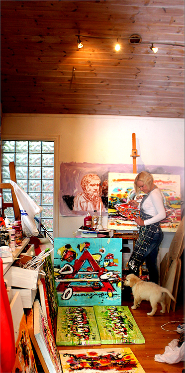 Photo courtesy of Agora Gallery Hilde Gustava and assistant at work in her atelier.